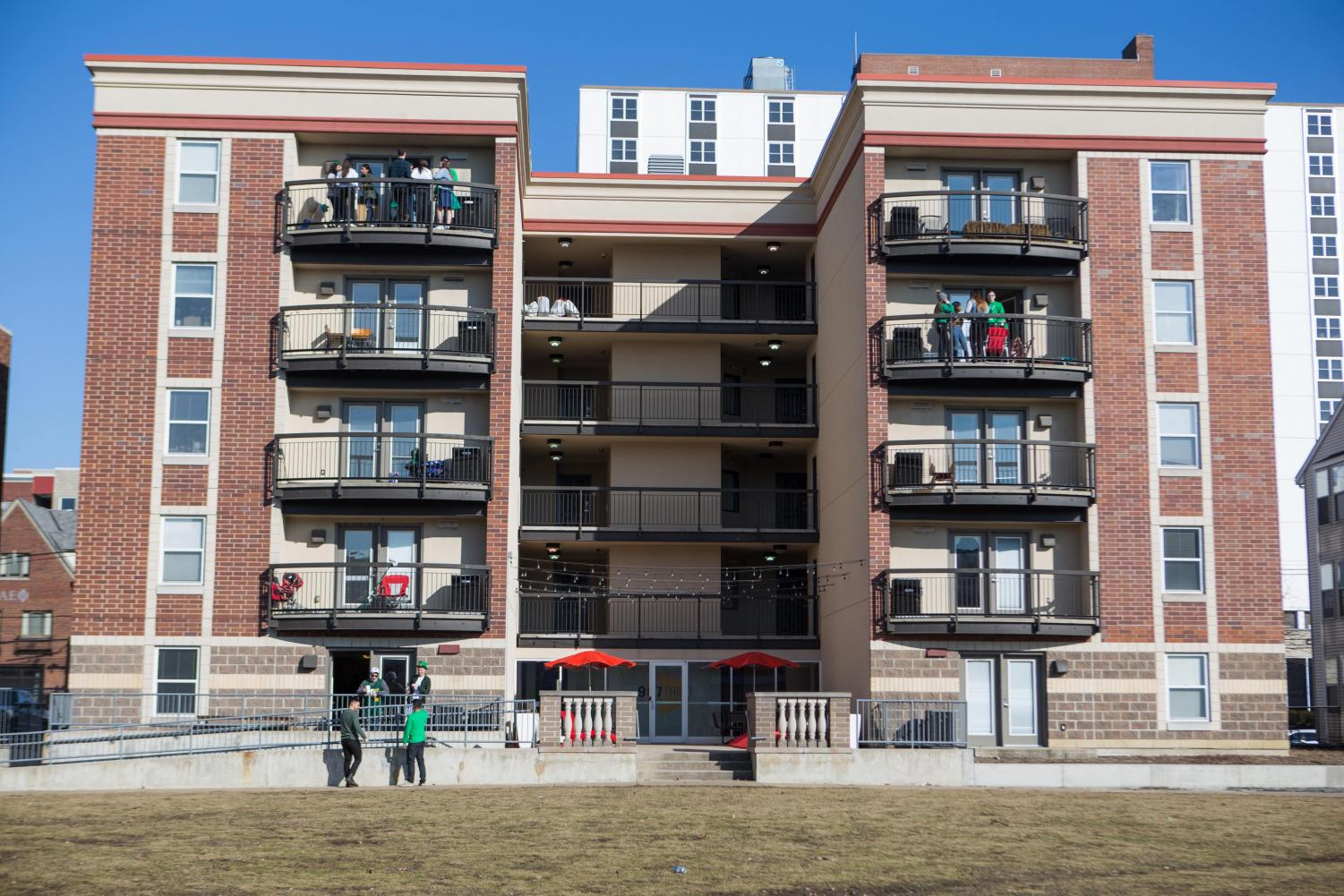 Participants+across+various+apartments+spend+time+on+balconies+celebrating+Unofficial+on+Friday.+Students+are+cautioned+ahead+of+time+not+to+overload+balconies+due+to+the+risk+of+collapse+caused+by+excessive+weight.