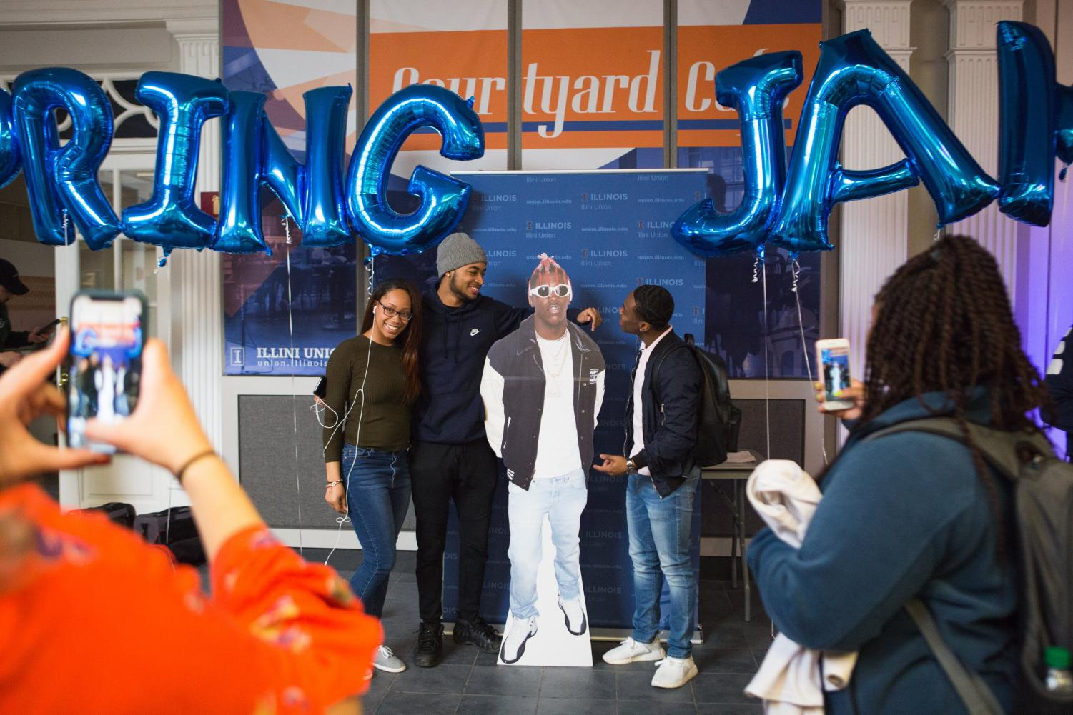 Students pose with a cutout of Lil Yachty as he was just announced as the performing artist for 2019's Spring Jam in the Courtyard Cafe on Thursday.