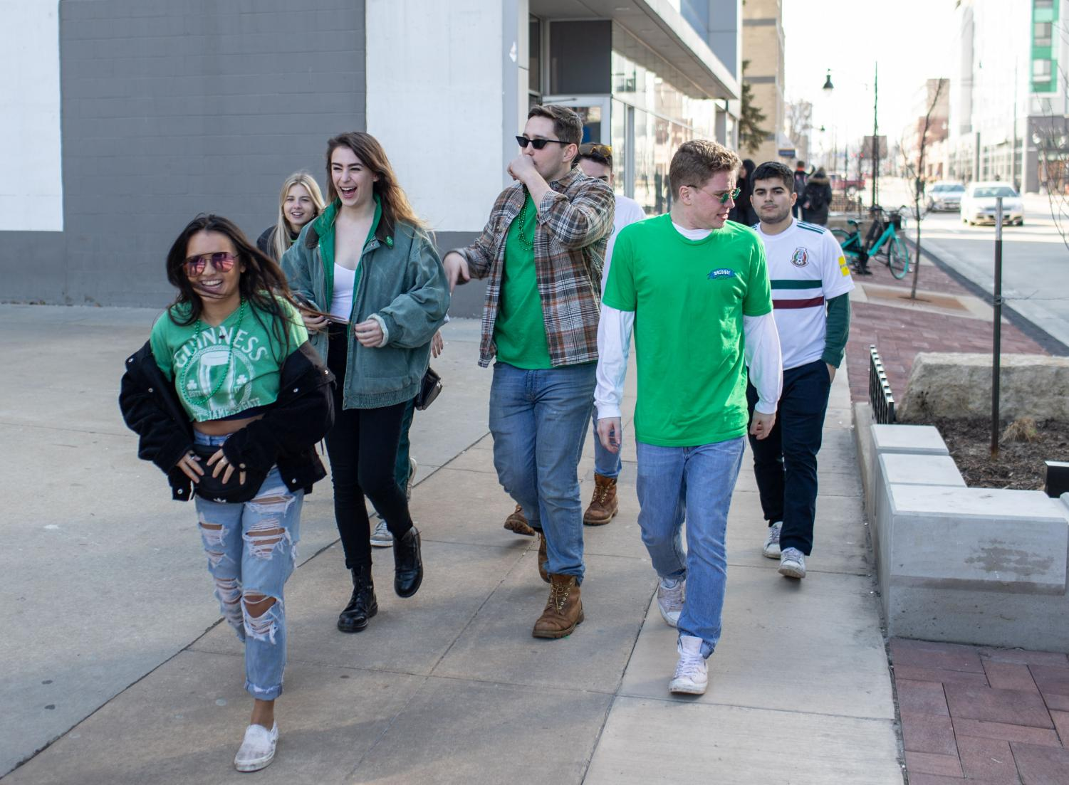 Unofficial+participants+walk+down+Green+Street+on+Friday.
