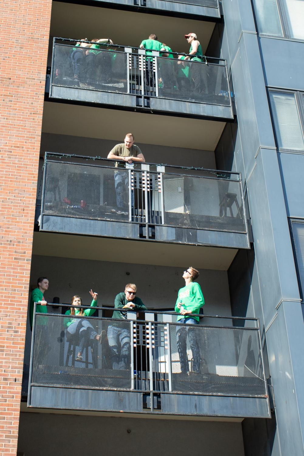 Participants+celebrate+Unofficial+on+their+balconies+during+Unofficial+on+Friday.