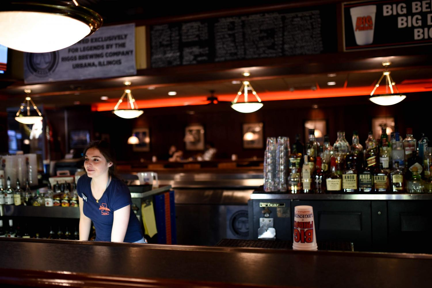 Annie Mokate, senior in AHS, prepares a drink for a customer at Legends Bar and Grill in Champaign on Feb. 22.