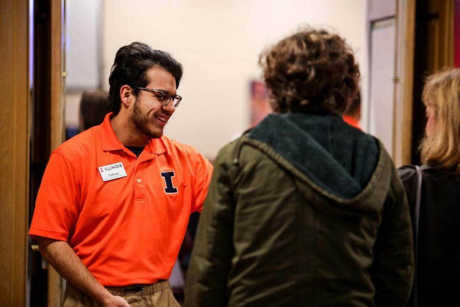 Fabian Guerrero, sophomore in the College of Fine arts, happily greets incoming freshman at the Union on Monday.