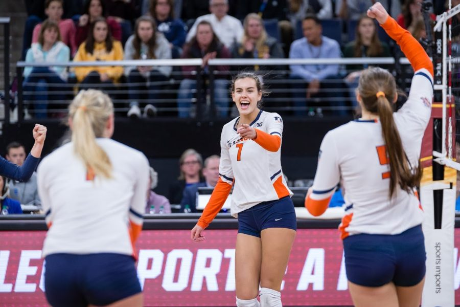 Illinois+outside+hitter+Jacqueline+Quade+%28center%29+points+to+setter+Jordyn+Poulter+%28left%29+after+scoring+a+kill+during+the+match+against+Nebraska+in+the+Final+Four+of+the+NCAA+tournament+at+the+Target+Center+on+Dec.+13.+Nebraska+defeated+Illinois+3-2.