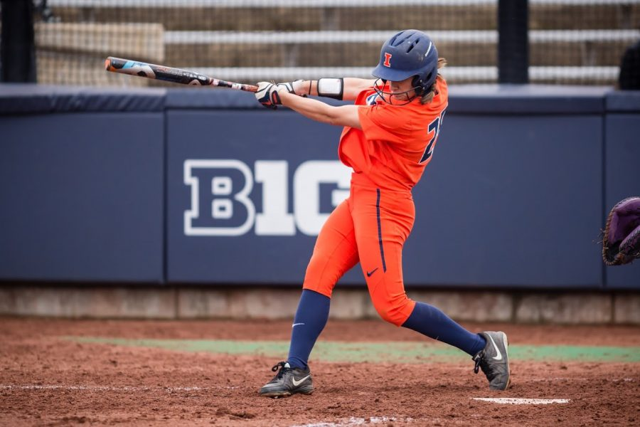 Illinois outfielder Carly Thomas (25) hits a home run during the game against Northwestern at Eichelberger Field on Wednesday, Mar. 28, 2018.