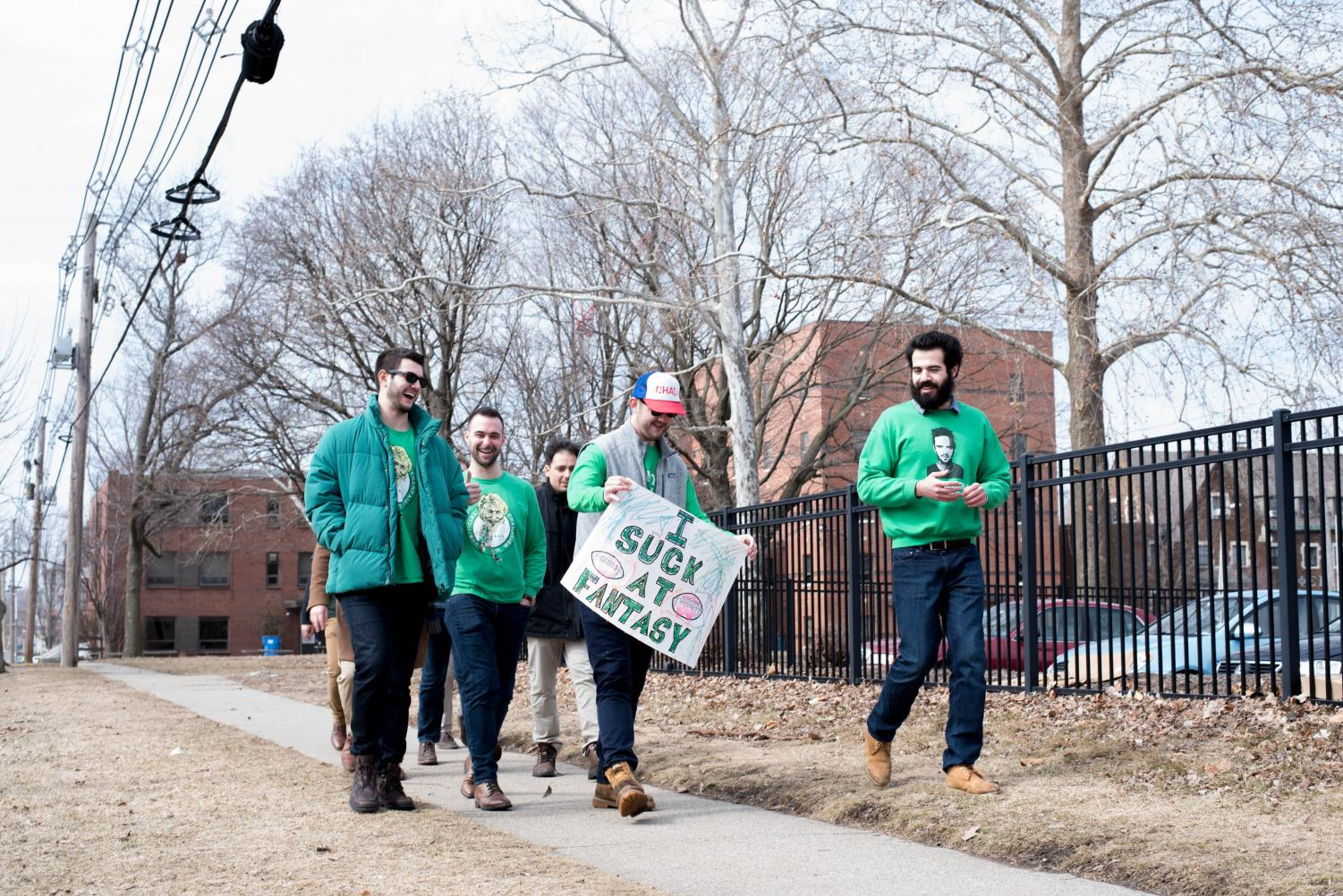 A+group+of+celebrators+walk+along+the+sidewalk+on+Gregory+Street+in+Champaign+on+Friday.