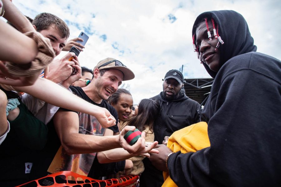 Lil Yachty comes down from the Spring Jam stage to say hello and sign things for fans.