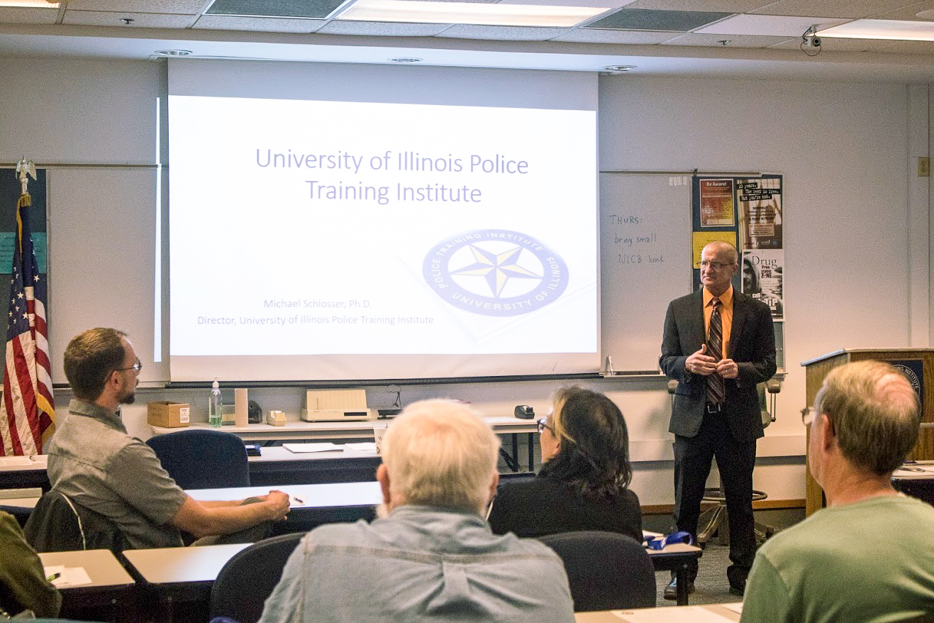 Michael Schlosser, director of the University of Illinois Police Training Institute, opens up his first class of Citizen Police Academy with introductions on April 4.  This 10-week course allows locals to be educated and informed about everything the University of Illinois Police do for the community.