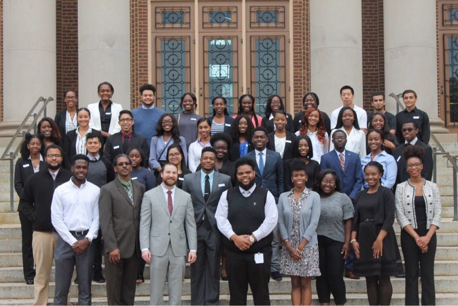 Members of UI's Student National Medical Association's initiative, Minority Association of Pre-Medical Students, pose with guest doctors and medical students in front of Foellinger Auditorium. A new study finds pre-medical students place importance on demographic representation in the American medical profession.