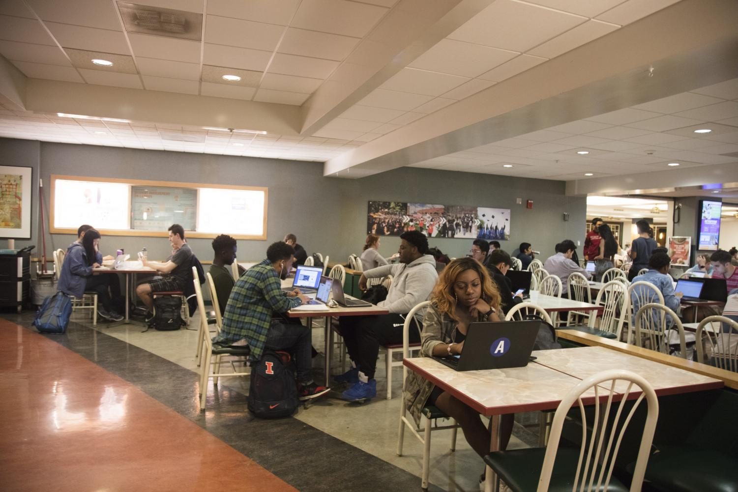 Students in the basement of the Illini Union on Tuesday. In light of recent concerns about security of internet-connected devices, the state of Illinois has passed new legislation banning manufacturers from collecting audio without consumers' consent. This new bill will calm the public's fear of invasion of privacy.
