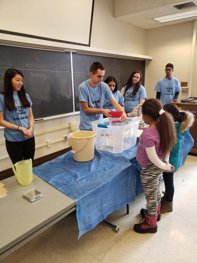 Members of Engineering Outreach Society test projects created by younger students during Engineering Open House on March 8. The University received a grant from the National Science Foundation to encourage more underrepresented students in middle and high school to pursue STEM fields.