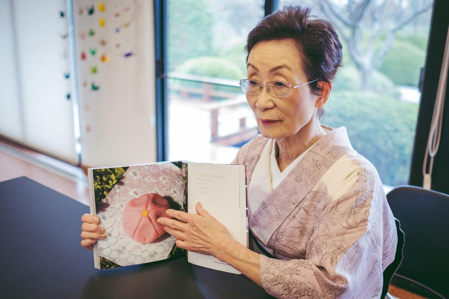 "Kimiko Gunji, former director of the Japan House in Champaign, speaks about her book, ""The Art of Wagashi,"" at the Japan House on Thursday. Wagashi are traditional Japanese desserts often served with tea to complement their sweetness."