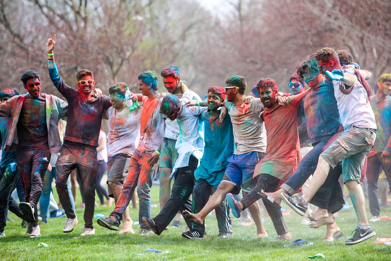 People celebrating Holi at the FAR fields on April 21. The event will take place on Saturday, and all students are welcome to attend.