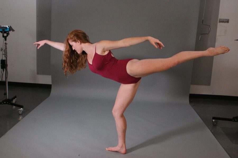 Jenny Oelerich poses in the first arabesque with supporting leg in plié. Oelerich said she had always been interested in education and teaches a morning yoga class through the University and a second grade dance class.