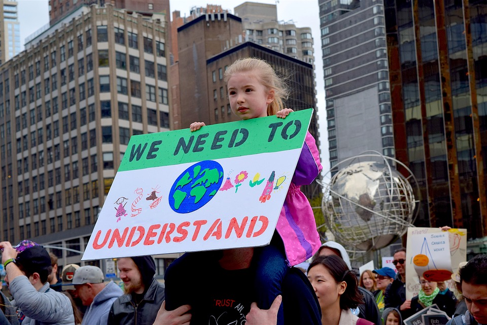 A young protester holds a sign during March For Science Protest. Columnist Cole notes the importance of paying attention to the roots of the Nationalist movements at home and abroad.