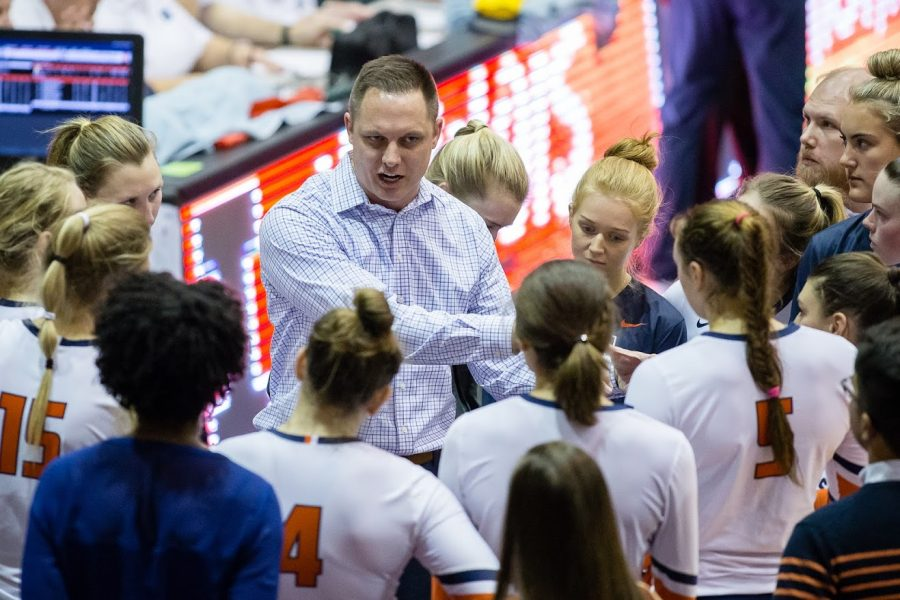 Illionois head coach Chris Tamas talks to his team during the match against Michigan at Huff Hall on Friday, Oct. 19, 2018. The Illini won 3-2.