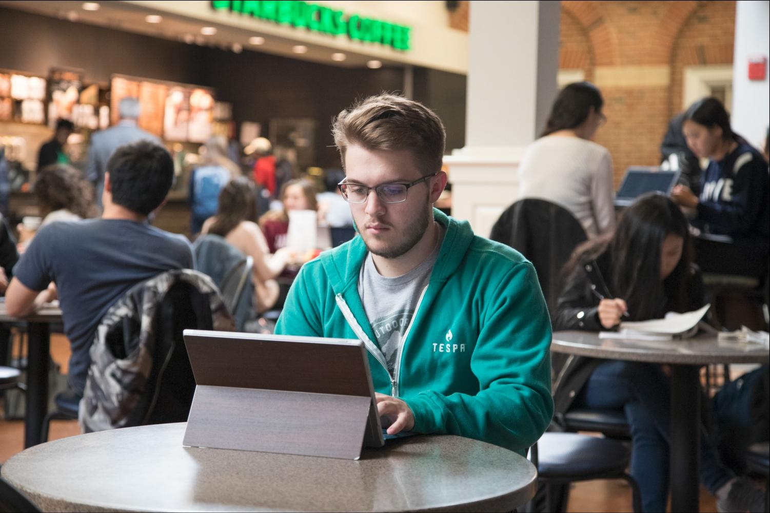 David Koruna, the president of Illini Esports, completes administrative work in Courtyard Cafe on Oct. 23.