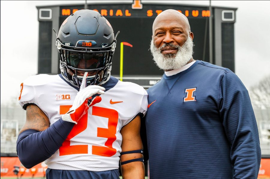 New+football+commit+Reggie+Love+III+poses+with+Lovie+Smith+at+Memorial+Stadium.+Three+new+recruits+comitted+to+Illinois+on+Monday+and+Tuesday.