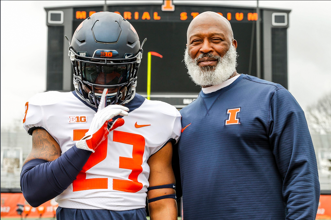 New football commit Reggie Love III poses with Lovie Smith at Memorial Stadium. Three new recruits comitted to Illinois on Monday and Tuesday.