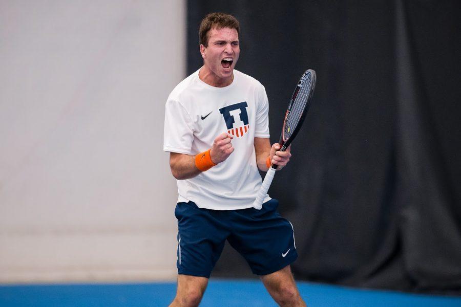 Illinois' Vuk Budic celebrates after winning his singles match against Penn State at Atkins Tennis Center on April 12. The Illini won 4-3.