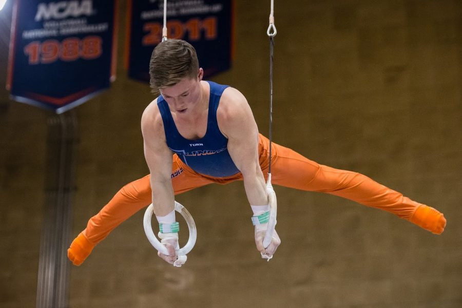 Senior+Alex+Diab+performs+on+the+still+rings+during+the+meet+against+Iowa+was+at+Huff+Hall+on+Jan.+26.+He+collected+his+second+straight+national+title+in+the+event+on+Saturday.