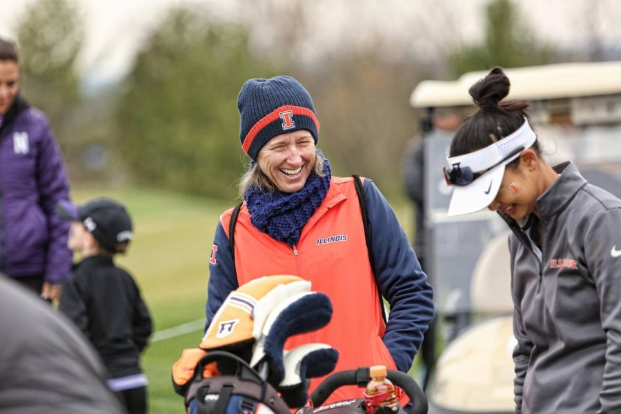 Women%E2%80%99s+golf+head+coach+Renee+Slone+laughs+alongside+an+Illini+golfer.+Slone+was+awarded+Big+Ten+Coach+of+the+Year.