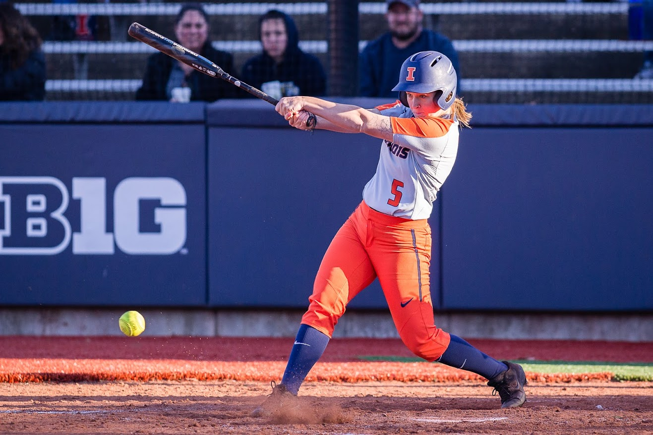 Illinois right fielder Kailee Powell (5) hits the ball during the game against Eastern Illinois at Eichelberger Field on Tuesday, March 26, 2019. The Illini won 8-7 in 8 innings.