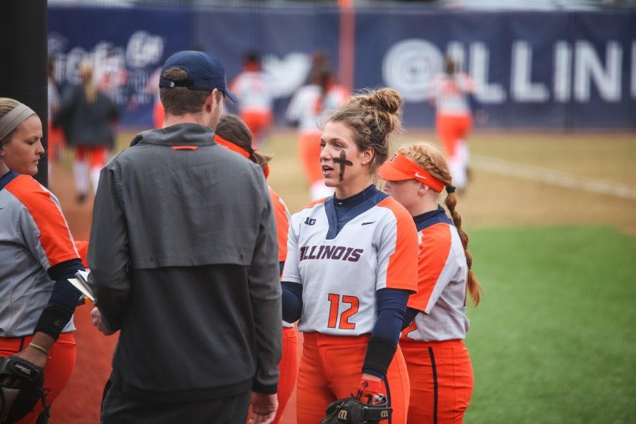 Taylor Edwards speaks to one of the Softball coaches at Eichelberger Field on April 3. Illinois defeated Illinois State 2-1. This game marked the end of a seven-game losing streak for the Illini.