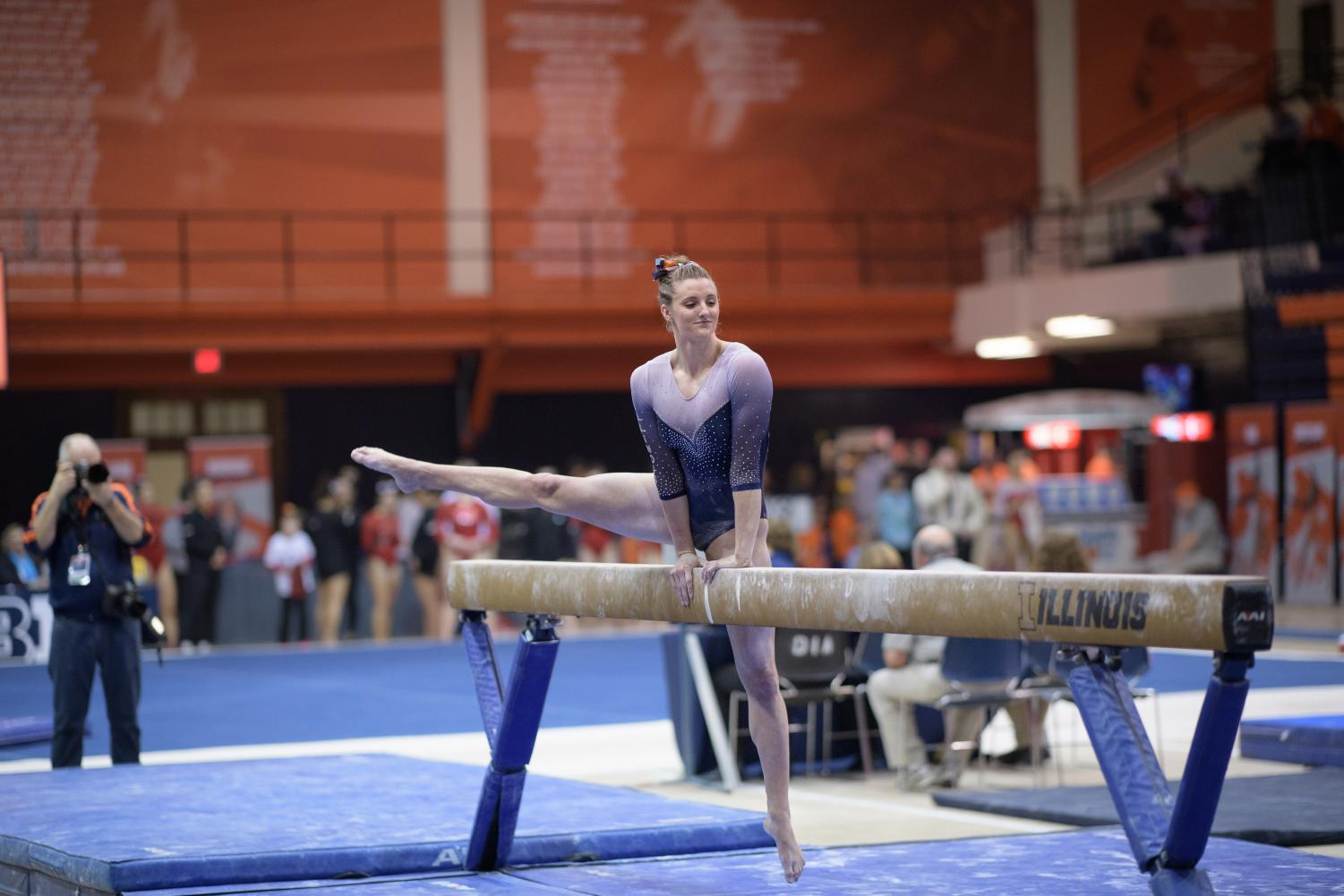 Mary Jane Otto performs on the balance beam at Huff Hall on March 9. The Illini finished second with a score of 196.075.