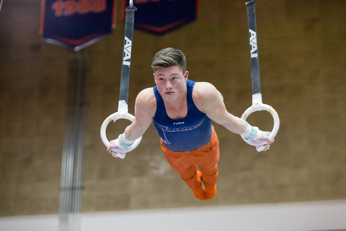 Illinois' Alex Diab performs on the still rings during the meet against Iowa at Huff Hall on Saturday, Jan. 26, 2019.