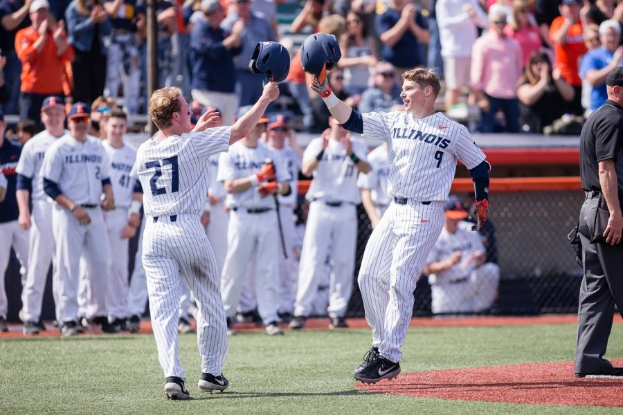 Catcher Jacob Campbell (right) celebrates with third baseman Grant Van Scoy (left) after hitting a homerun during game one of the doubleheader against Maryland at Illinois Field on April 6. The Illini won 5-1.