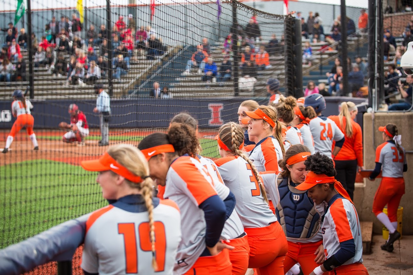 The Illini cheer on their batter in the dugout at Eichelberger Field April 3.  Illinois will be looking to secure a final series win against Purdue next weekend.