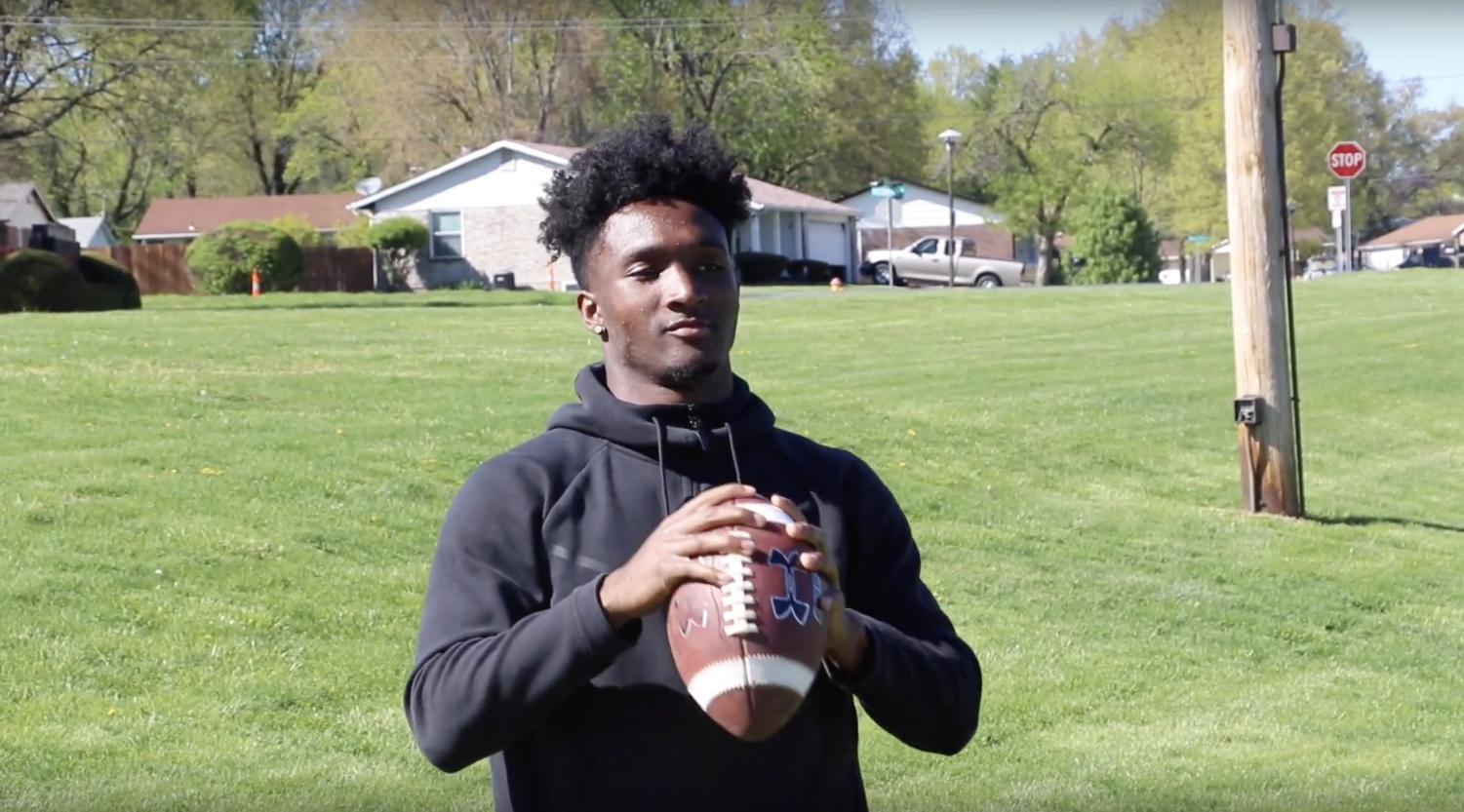 lllinois football recruit Isaiah Williams plays catch near his home in the St. Louis-area. Williams is a quarterback with significant arm talent, and tight end coach Cory Patterson played a role in his decision to play for Illinois.