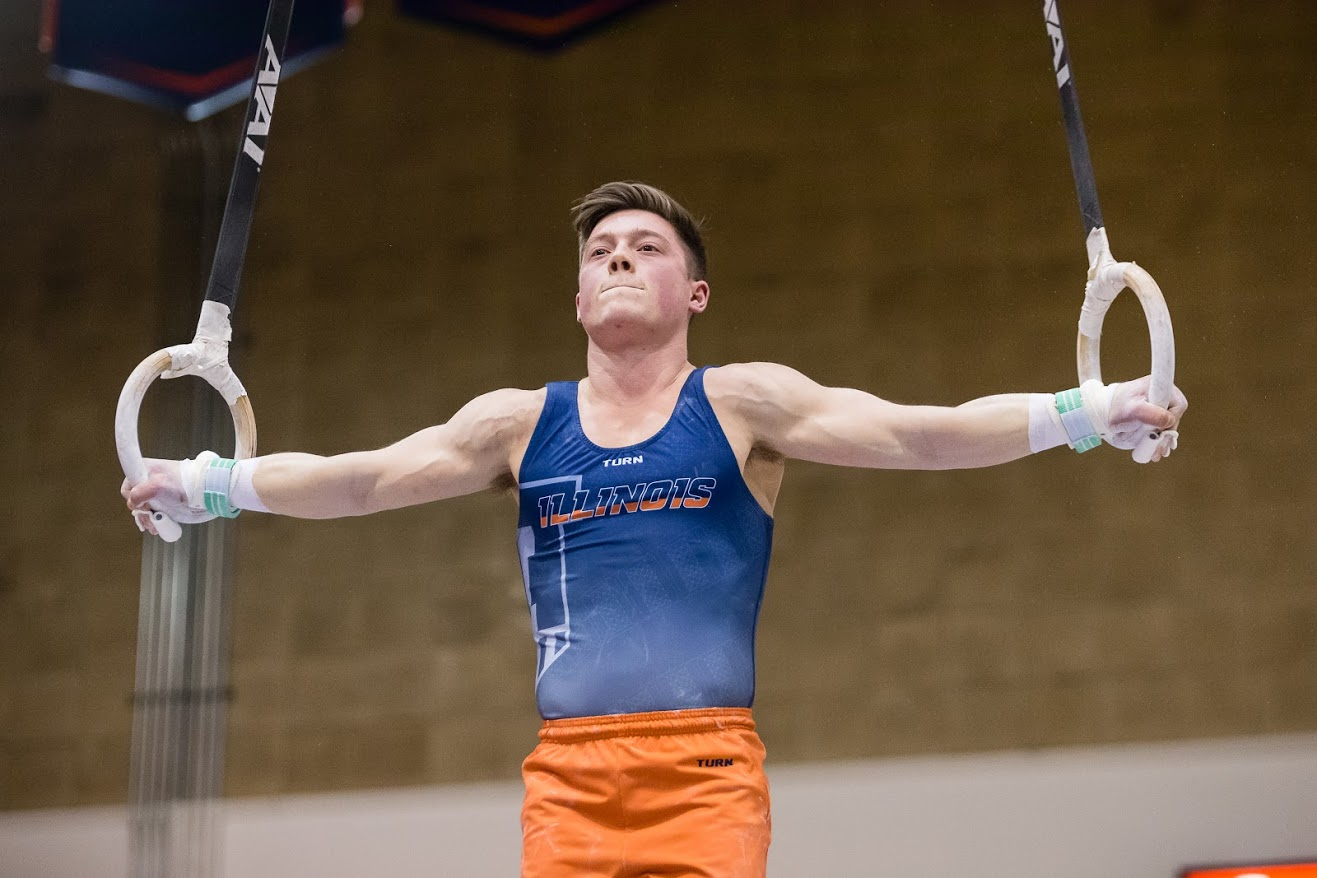 Alex Diab performs on the still rings during the meet against Iowa at Huff Hall on Jan. 26. Diab has accumulated 41 total event titles.