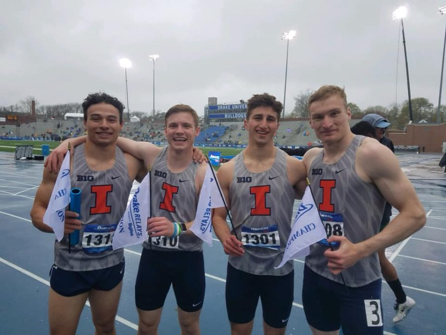 Sophomore Jason Shannon, freshman Declan Rustay and seniors Joe Haight and Devin Quinn smile after winning their race. The men's 4x100-meter relay won the final on Saturday.