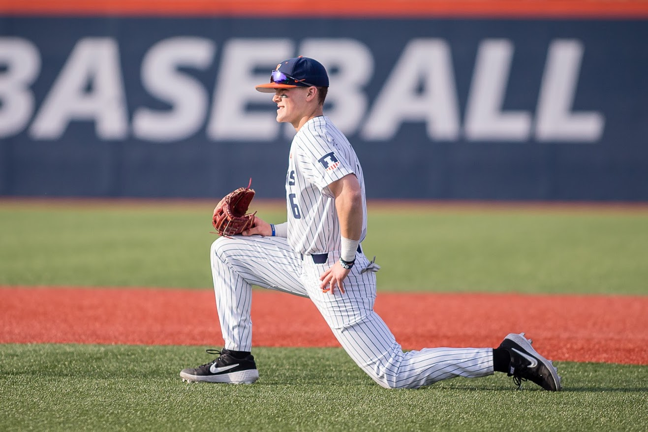 Designated hitter Michael Massey stretches during a break in game two of the doubleheader against Maryland at Illinois Field on April 6. The Illini lost 8-4.