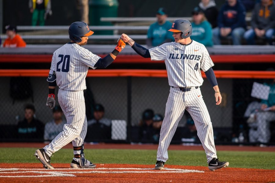 Illinois+second+baseman+Branden+Comia+%28left%29+celebrates+with+shortstop+Ben+Troike+%28right%29+after+hitting+a+two-run+home+run+during+the+game+against+Coastal+Carolina+at+Illinois+Field+on+Tuesday.+The+Illini+won+4-2.