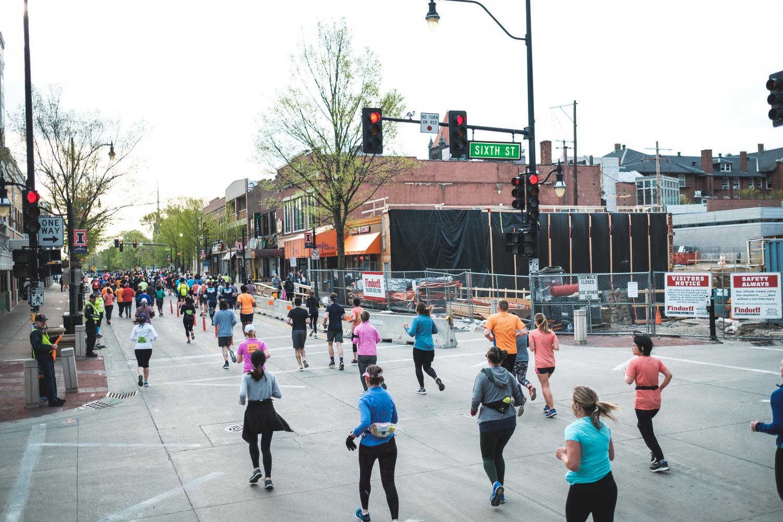 Participants of the Illinois Half Marathon run on Green Street on Saturday.