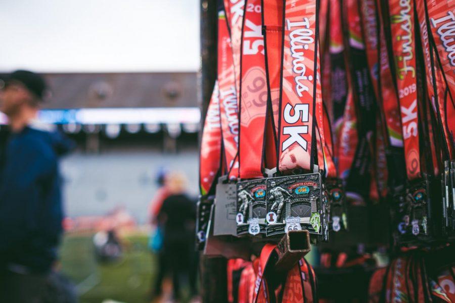 Medals+for+the+Illinois+Marathon+5k+are+displayed+inside+Memorial+Stadium+on+Saturday.