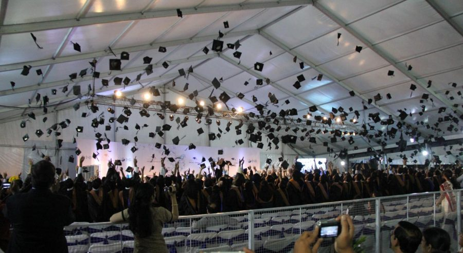 Indian School of Business students throw their caps after the graduation ceremony in Hyderabad, India. Special sections editor Ava urges graduates to be optimistic about the future.