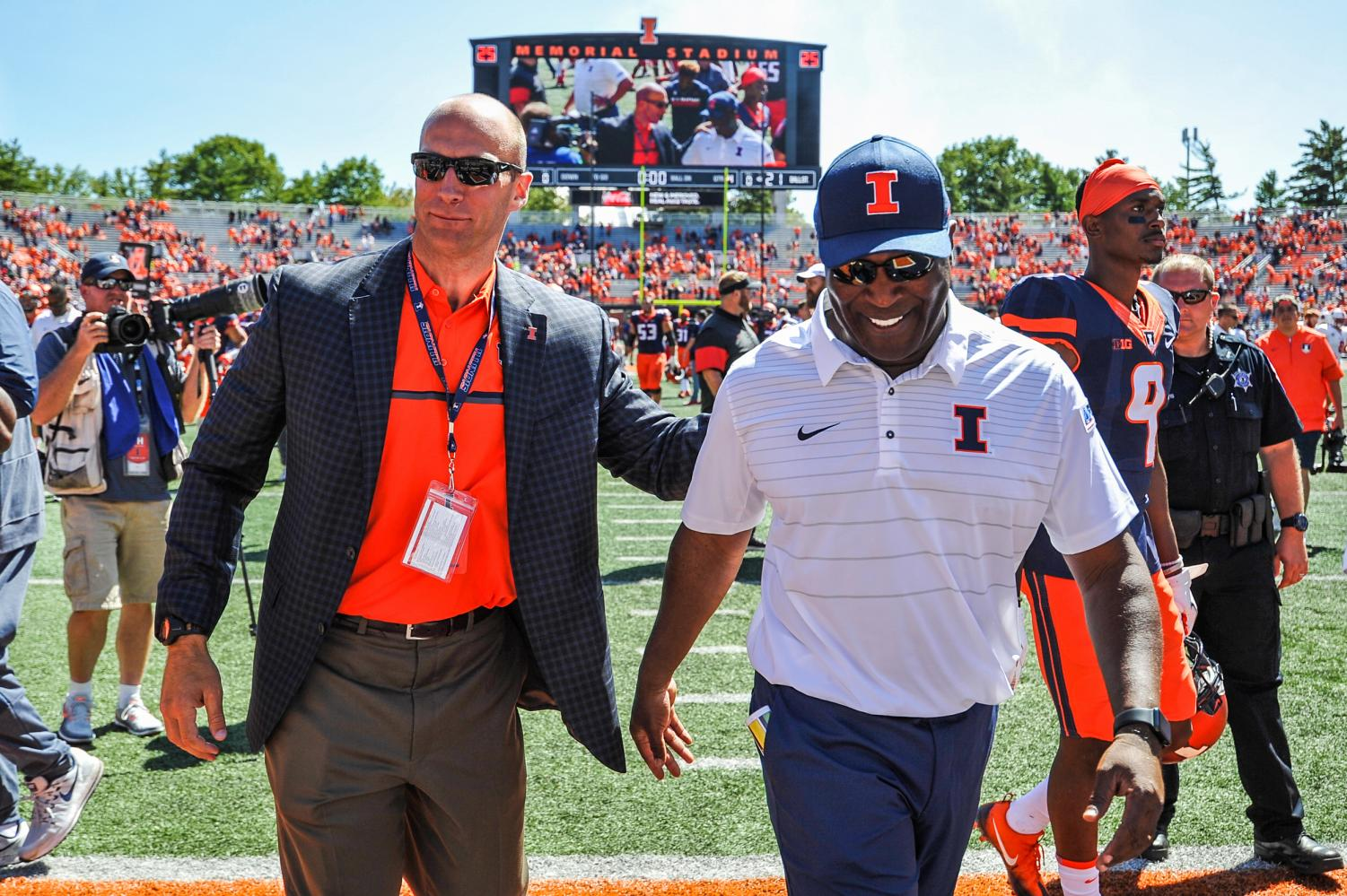 Illinois Athletic Director Josh Whitman (left), and head football coach Lovie Smith (right), walking inside Memorial Stadium.