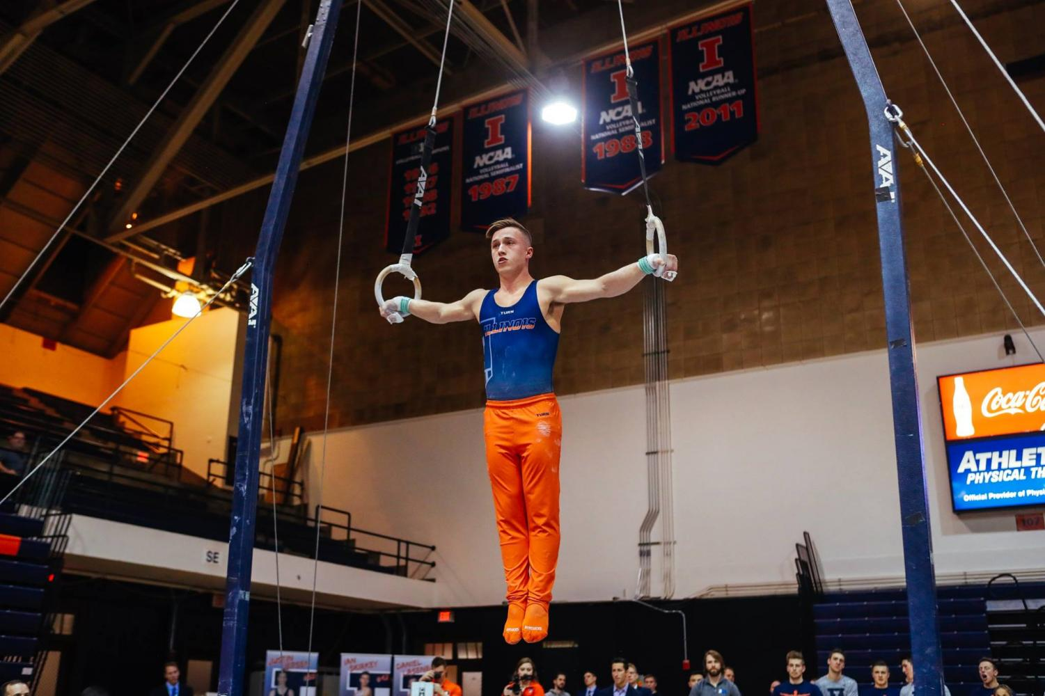 Max Diab performing on the rings at Huff Hall