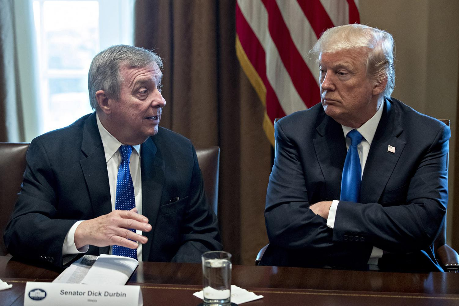 U.S. President Donald Trump, right, listens as Senator Dick Durbin, D- Ill., speaks while meeting with bipartisan members of Congress on immigration in the Cabinet Room of the White House in Washington, D.C., U.S., on Tuesday, Jan. 9, 2018.