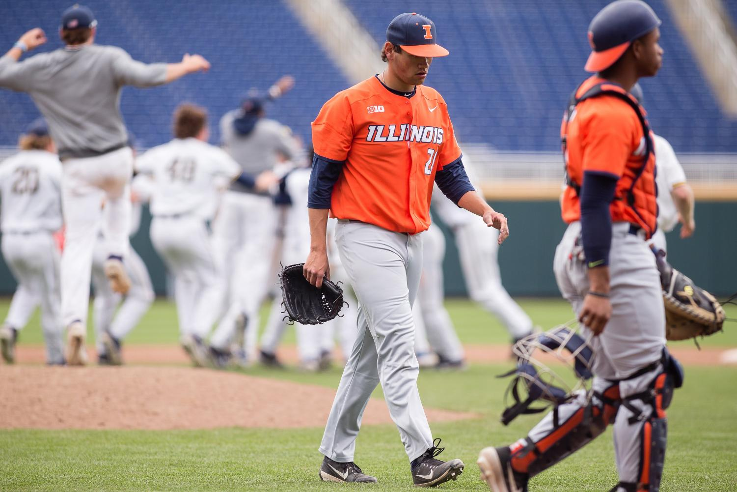 Illinois closing pitcher Garrett Acton (26) walks off the field after giving up a walk-off two-run double the game against Michigan in the Big Ten Tournament at TD Ameritrade Park on Thursday, May 23, 2019. The Illini lost 5-4. Photo by Austin Yattoni of The Daily Illini.