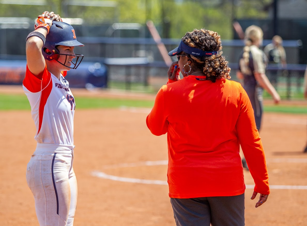 Head coach Tyra Perry speaks with Annie Fleming (99) during a Purdue Pitching Change on Sunday. The Illini won 12-4.