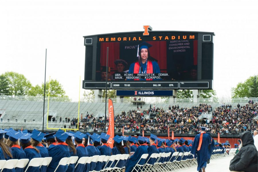 Crowds+overlook+the+commencement+stage+at+Memorial+Stadium.+The+University+held+a+University-wide+commencement+ceremony+on+May+11%2C+2019.