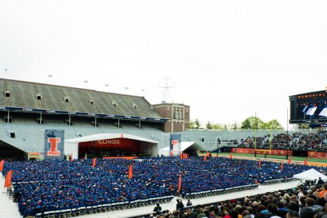 Crowds overlook the commencement stage at Memorial Stadium. The University held a University-wide commencement ceremony on May 11, 2019.
