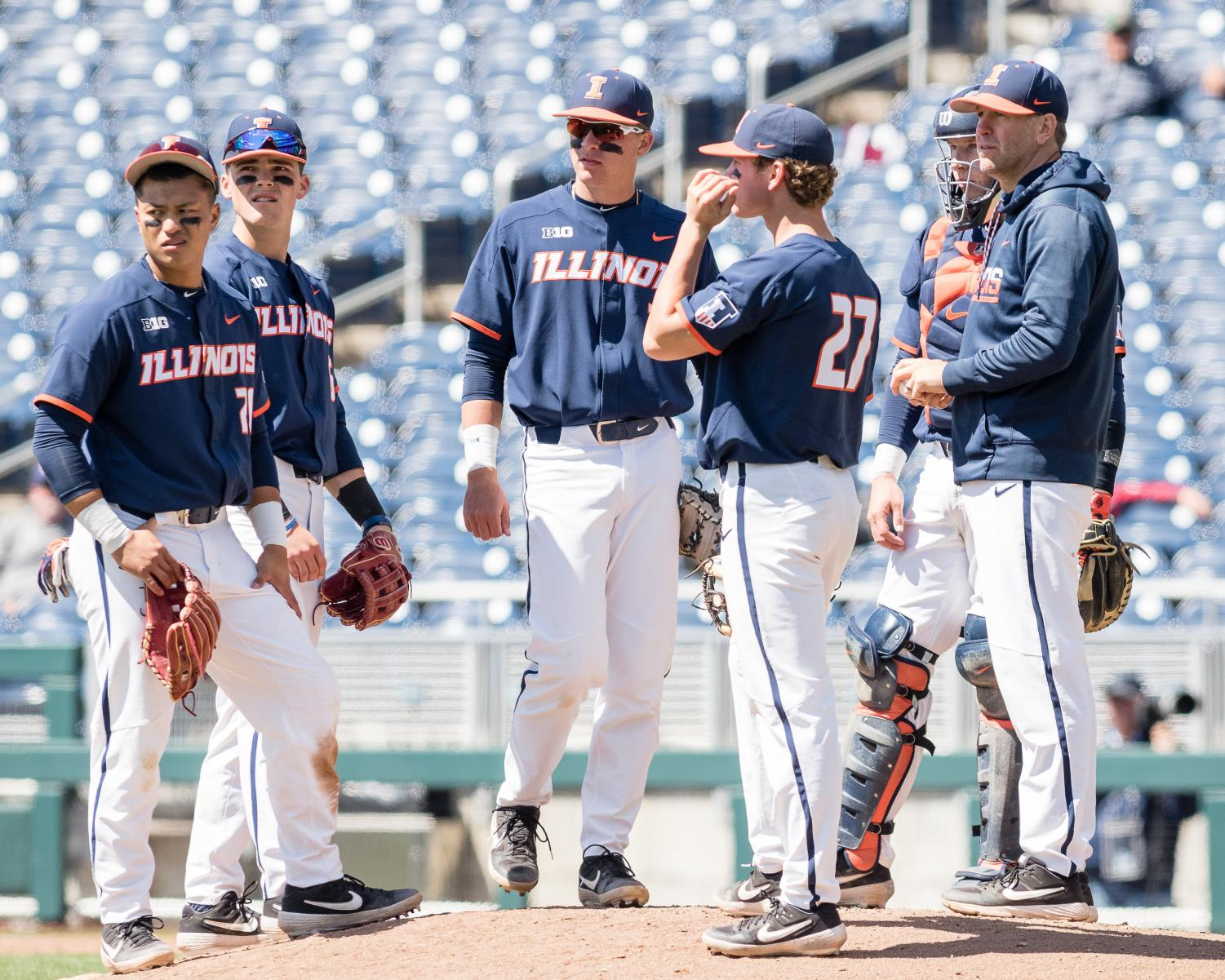 Members of the Illinois infield look to the bullpen for the next pitcher during the game against Maryland in the Big Ten Tournament at TD Ameritrade Park on Wednesday, May 22, 2019. The Illini lost 6-2.  Austin Yattoni of The Daily Illini.