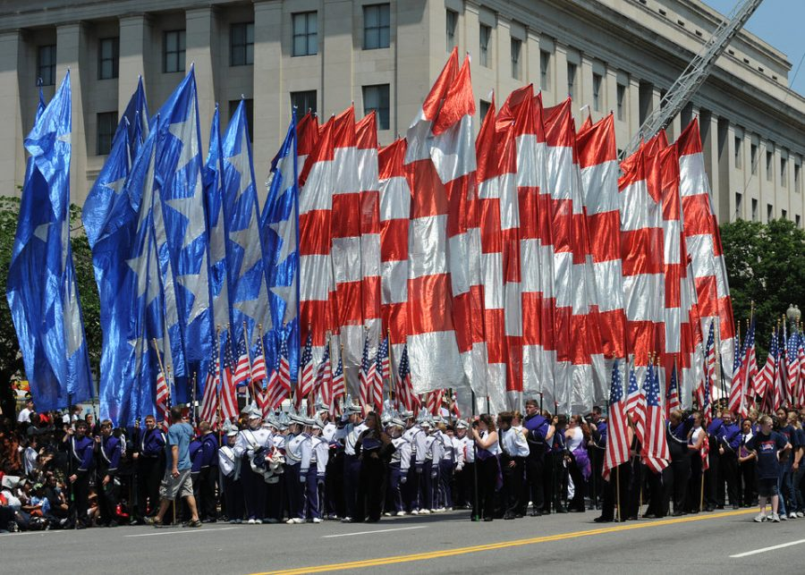 A+precession+of+flags+is+carried+by+volunteers+at+the+National+Memorial+Day+Parade+on+May+28%2C+2012+in+Washington+D.C.+The+annual+National+Memorial+Day+Parade+is+an+opportunity+for+thousands+of+patriotic+Americans+to+come+together+and+honor+those+who+have+sacrificed+so+much+in+service+to+our+country.