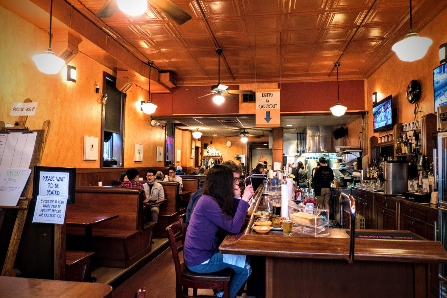 Customers dine at Black Dog Smoke & Ale House in Urbana on April 30. C-U offers many restaurant options that accommodate any specification.
