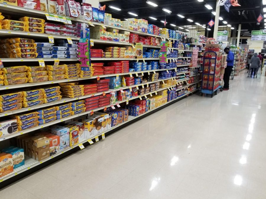 Snacks line shelves in County Market in Champaign. Students without transportation may have a difficult time regularly shopping for groceries, so on-campus options are available.